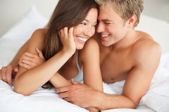 Passionate couple enjoying on the bed Royalty Free Stock Images