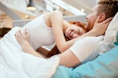 Passionate couple foreplay in bed. With sensuality Stock Photography