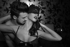 Passionate couple foreplay black and white Royalty Free Stock Photo