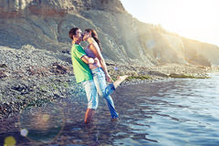 Passionate couple kissing on the beach stock photo