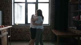 Passionate couple moving in slow dance in kitchen stock video