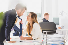 Passionate couple in the office Stock Photography