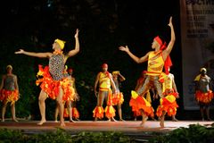 Passionate dance performance at Folklore Festival stage Stock Image