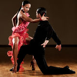 Passionate dancers. In red dress dancing pasodoble Royalty Free Stock Photos
