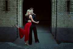 Passionate dancers dancing tango. Royalty Free Stock Images