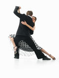 Passionate dancing couple on white background. Passionate, young couple showing dance moves on white background stock photo