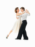 Passionate dancing couple on white background. Passionate, young couple showing dance moves on white background Royalty Free Stock Photography