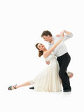 Passionate dancing couple on white background. Passionate, young couple showing dance moves on white background Stock Photography