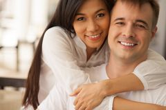 Passionate embrace. Portrait of a young women embracing her boyfriend Royalty Free Stock Images
