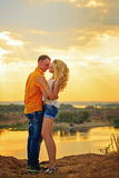 Passionate embrace at sunset. Stock Images