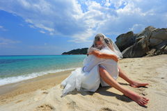 Passionate embrace on a tropical beach Stock Photo