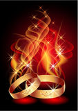 Passionate engagement rings. Wedding rings in abstract flames and smoke Stock Image