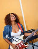 Passionate Female Playing Guitar Royalty Free Stock Photography