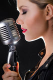 Passionate female rock singer Stock Photography