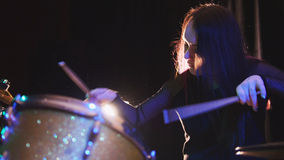 Passionate girl with long hair - percussion drummer perform music break down - teen rock music. Telephoto Royalty Free Stock Image