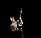 Passionate guitarist. Against black background Royalty Free Stock Photo