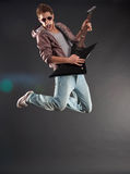 Passionate guitarist jumps Stock Photos