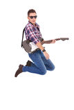 Passionate guitarist jumps in the air Stock Images