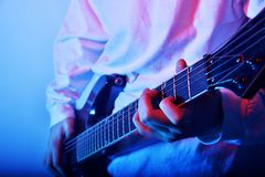 Passionate Guitarist Music Concept Photo. Electric Guitar Playing Closeup Photo. rock music band. royalty free stock images