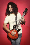 Passionate guitarist playing with beautiful long curly hair play Royalty Free Stock Photo