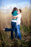 Passionate Kiss. A young, attractive couple shares a passionate kiss. Selective focus on the couple royalty free stock photography