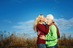 Passionate kiss on nature Royalty Free Stock Image
