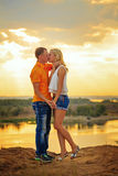Passionate kissing at sunset. Stock Photography