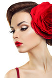 Passionate lady with a red flower in her hair. Beautiful lady with a big red flower Stock Images