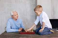 Passionate lively gentleman proud of his grandson Royalty Free Stock Photography