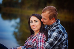 Passionate love in the autumn park. A young couple Stock Images