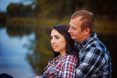 Passionate love in the autumn park. A young couple Royalty Free Stock Images