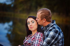 Passionate love in the autumn park. A young couple. Stock Images