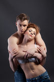 Passionate lovers embracing in front of camera Stock Photography