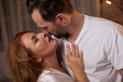 Passionate loving couple kissing with fondness. Voluptuous women is enjoying kiss of her lover. They are hugging with passion Royalty Free Stock Photo