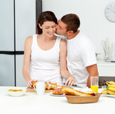 Passionate man kissing his girlfriend Stock Image