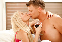 Passionate married couple enjoying in bed Stock Photography