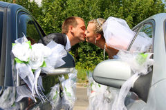 Passionate married couple kissing. With car windows stock photography