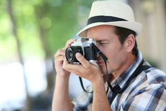 Passionate photographer making shots outdoors Stock Images