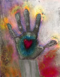 Passionate Proof. Hand Print with glowing heart and fingers lit with energy Stock Photo