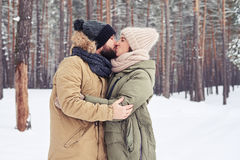 Passionate romantic young couple kissing and embracing outdoors Royalty Free Stock Images