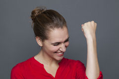 Passionate 20s girl for winning behavior concept. Winning behavior concept - passionate 20s girl laughing and gesturing for successful achievement and motivation Royalty Free Stock Photo