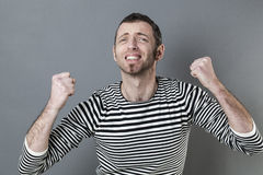 Passionate 40s man expressing regrets Royalty Free Stock Photography