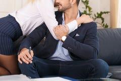 Passionate secretary seducing rich businesswoman in office stock photos