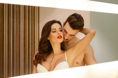 Passionate sensual couple in mirror Stock Photos