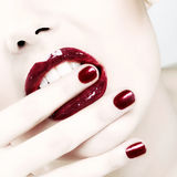 Passionate shiny red lips. And nails stock photography