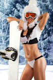 Passionate sportswoman. Young passionate sportswoman with snowboard stock image