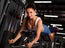Passionate, sporty woman training at the gym Stock Image