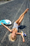 Passionate woman lying on road Royalty Free Stock Photo