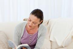 Passionate woman reading a fiction Stock Photo