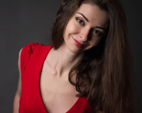 Passionate woman in a red dress Royalty Free Stock Images